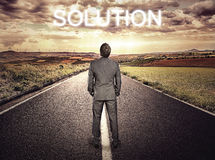 Businessman searching for solution Stock Images
