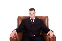 Businessman seated on a chair Stock Images