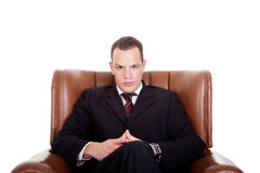 Businessman seated on a chair Stock Photo