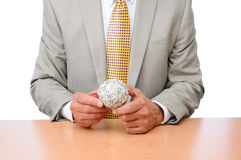 Businessman Seated at Desk With Ball of Money Royalty Free Stock Images