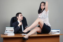 Businessman with secretary. Businessman with beauty secretary in office royalty free stock photo