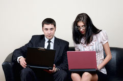 Businessman with secretary. Businessman with beauty secretary in office stock images