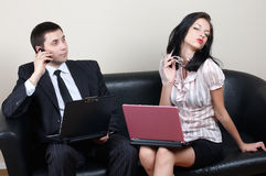 Businessman with secretary. Businessman with beauty secretary in office royalty free stock image