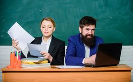 Businessman and secretary. back to school. Formal education. paper work. office life. business couple use laptop and stock image
