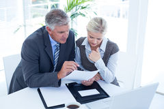 Businessman with secretary checking file. In an office Royalty Free Stock Photo