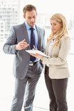 Businessman and secretary looking at diary in office Stock Photos