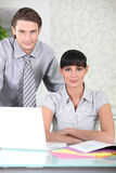 Businessman and secretary in office Royalty Free Stock Photos
