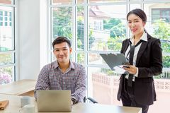 Businessman and secretary. Professional asian businesspeople working on computer. Asian people stock photo