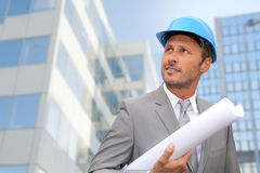Businessman with security helmet Stock Image