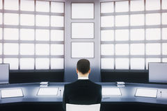 Businessman in security room Royalty Free Stock Photos