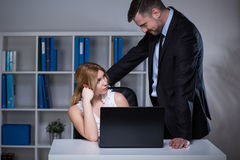 Businessman seducing assistant Royalty Free Stock Images
