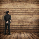 Businessman see board and get idea on Wood walls and floor Royalty Free Stock Photography