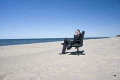 Businessman seeks relaxation Stock Images