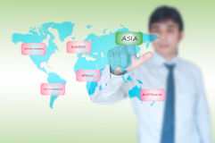 Businessman selecting Asia button Royalty Free Stock Photography