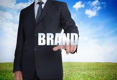 Businessman selecting brand word Royalty Free Stock Photos
