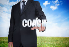 Businessman selecting coach word Stock Photography