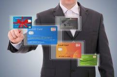 Businessman selecting a credit card Stock Photos