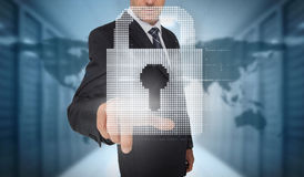 Businessman selecting a digital padlock Stock Photo