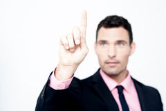 Businessman selecting, focus on finger Royalty Free Stock Photos