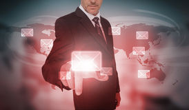 Businessman selecting futuristic email interface. On world map background Stock Photos