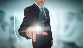 Businessman selecting a futuristic interface with arrows Stock Photo