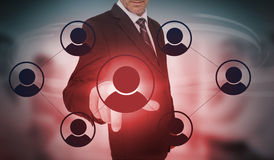 Businessman selecting futuristic interface of social network icons. On blurry office background Stock Photos
