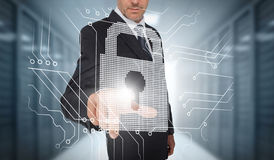 Businessman selecting a futuristic padlock Royalty Free Stock Images