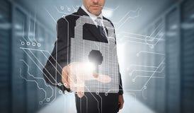 Businessman selecting a futuristic padlock Royalty Free Stock Images