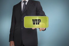 Businessman selecting green label with vip written on it Royalty Free Stock Image