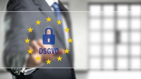 Businessman selecting an icon with many stars and the German abbreviation for `GDPR `. Businessman selecting an icon with many stars and the German abbreviation royalty free stock photography