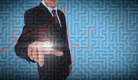Businessman selecting a labyrinth Royalty Free Stock Image