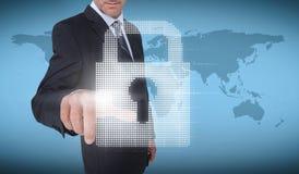 Businessman selecting a padlock Stock Image