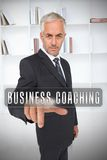 Businessman selecting the term business coaching Stock Photography