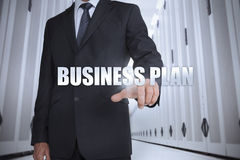 Businessman selecting the term business plan Royalty Free Stock Photos