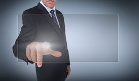 Businessman selecting a transparent screen Royalty Free Stock Photos