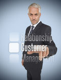 Businessman selecting the word customer Stock Photo