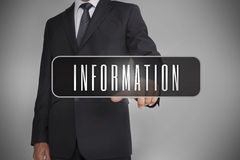 Businessman selecting the word information written on black tag Stock Photo