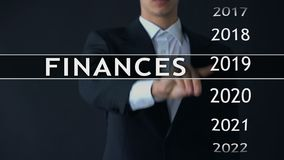 Businessman selects 2021 finances report on virtual screen, money statistics. Stock footage stock video footage
