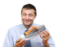 Businessman seller with shoe in hand Royalty Free Stock Photo