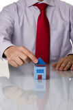 Businessman selling a house Stock Image