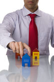 Businessman selling a house Stock Photography