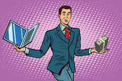 Businessman selling laptops Stock Image