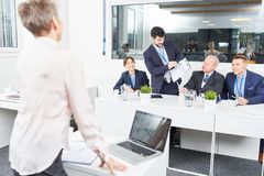 Businessman in seminar in discussion Royalty Free Stock Photography