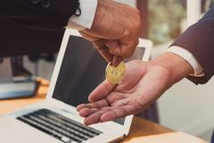 Businessman send bitcoin and receive money. Exchange with laptop computer, Digital money trade network at office workplace Royalty Free Stock Image