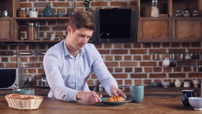 Businessman send mother picture his croissant stock video footage