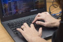Businessman sending email correspondence online on laptop comput Stock Photos