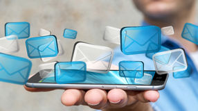 Businessman sending emails with phone '3D rendering'. Businessman with digital email icons over  mobile phone '3D rendering Royalty Free Stock Image