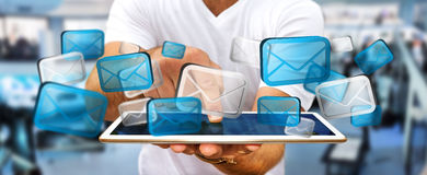 Businessman sending emails with phone '3D rendering'. Businessman with digital email icons over  mobile phone '3D rendering Stock Images