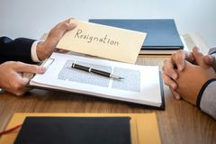 Businessman sending a resignation letter to employer boss in order to dismiss contract, changing and resigning from work concept royalty free stock image