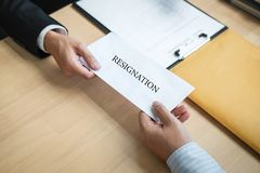 Businessman sending a resignation letter to employer boss in order to resign dismiss contract, changing and resigning from work. Concept royalty free stock photo